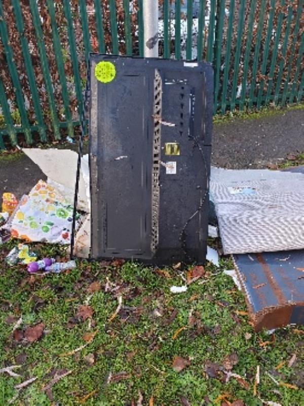 flytipping under investigation sticker. Please can it be removed from the front of the school as parents are complaining. -100 Ashampstead Road, Reading, RG30 3LJ