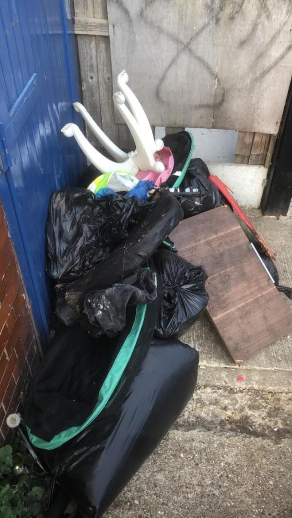 Fly tipping outside the fire exit at Salvation Army, 42 Wakefield Street.-42 Wakefield Street, East Ham, E6 1NQ