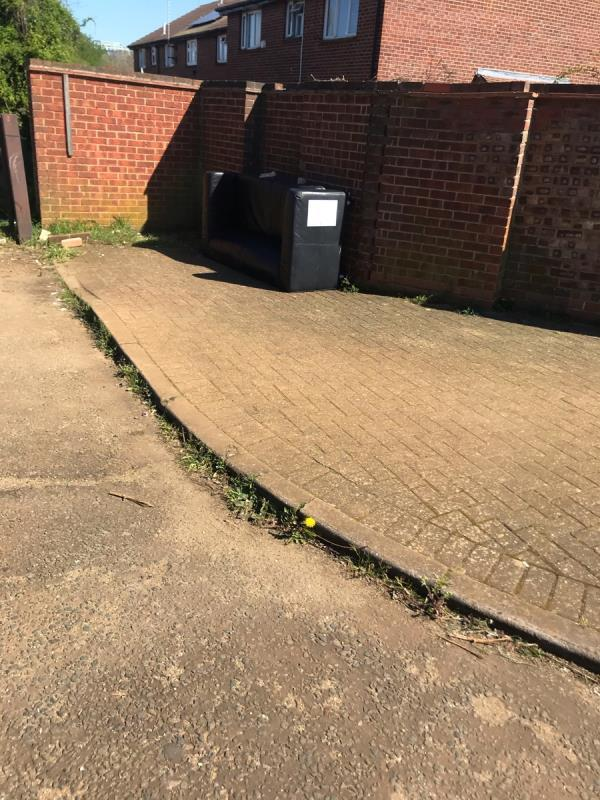 Dumped sofa is located on Marnham Crescent junction Millet Road at the entrance to Marnham Fields Ub6 -164 Marnham Crescent, London, UB6 9SZ