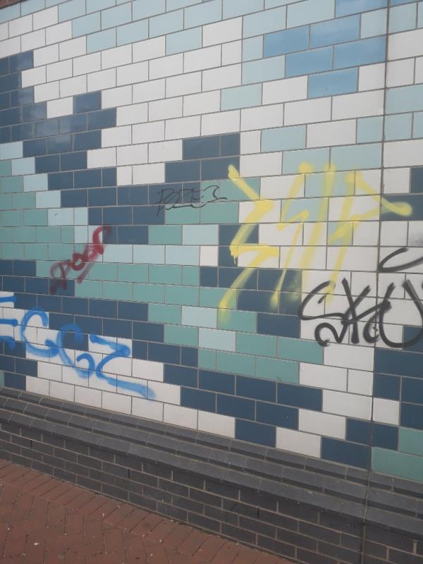 Dolphin Tower, Remove graffiti from wall by entrance: Reported by Lewisham Homes-Se8 5tg