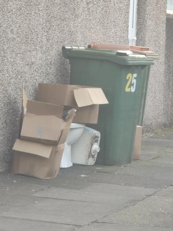 Someone has fly tipped some rubbish Inc. An old toilet on the pavement -25b Westbury Road, Green Street East, E7 8BU