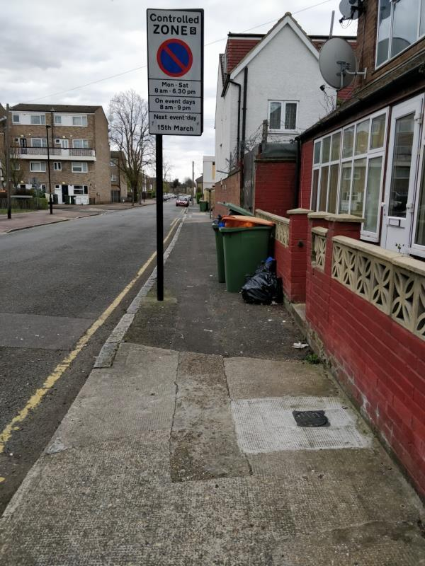 Dumped bags of rubbish on the pavement at 56 Ash Road E15-56 Ash Road, London, E15 1HL