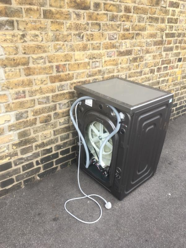 Fly-tipped washing machine, Samsung-2 Albert Square, London, E15 1HH