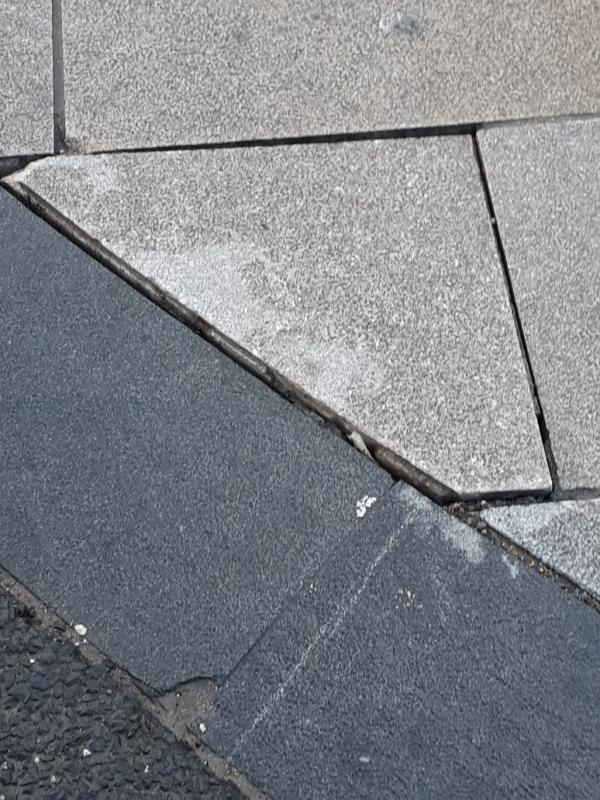 paving lifted.  trip, slip hazard-Site Offices, 4 Silvertown Way, London, E16 1EF