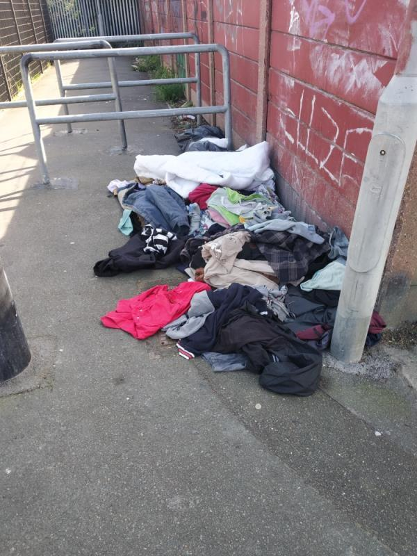 someone through some clothes-157 Park Ave, East Ham, London E6 2PN, UK