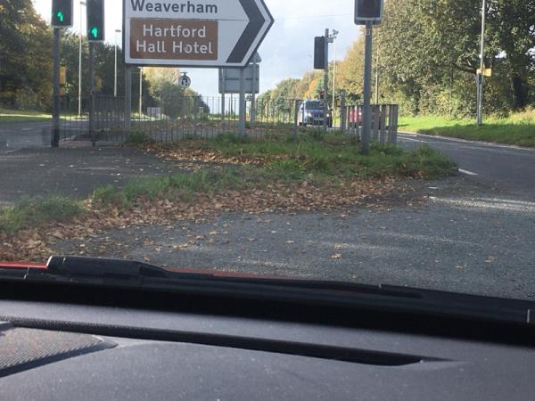 Central island in road overgrown, has litter and is an eyesore having been like this for a long time. Needs shovelling up and weed killer-108 School Ln, Hartford, Northwich CW8 1PN, UK