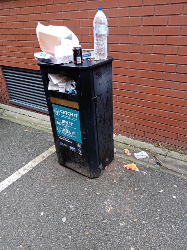 Street litter bin outside 3 Colton Square is overflowing.  Litter is now on the pavement surrounding the bin.-3 Colton Square, Leicester, LE1 1QH