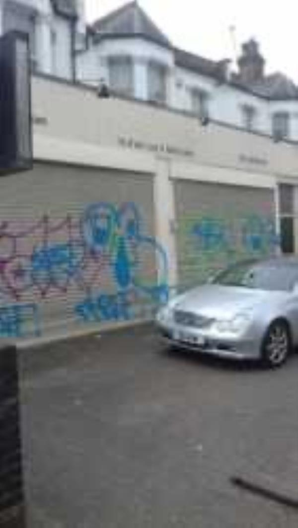 Remove graffiti from shutter-184 Brownhill Road, London, SE6 2DJ