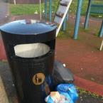 Residents leave their open domestic garbage by the playground bin - please help, they do this daily.-16 Churchill Walk, London, E9 6EP
