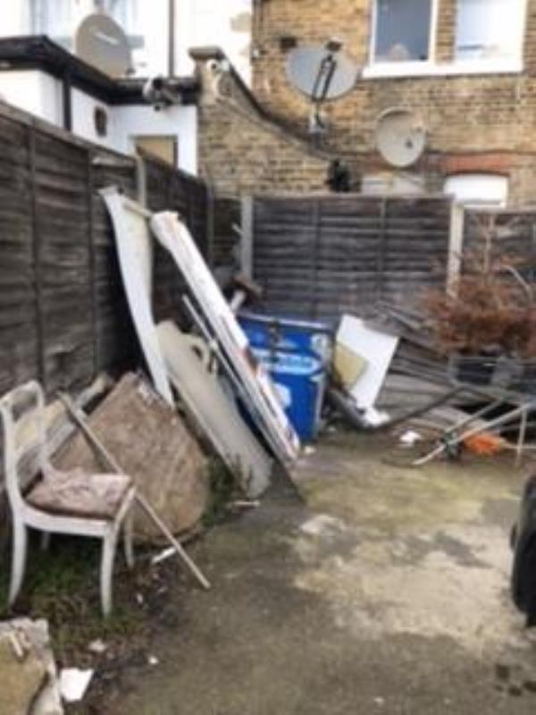 Behind the Monioro Solicitors and the newsagents (number 54 and 52), in the small car park area there had been a large number of recent fly tipping. This is used as a parking space but with no cars in overnight people have been leaving lots -48a Sydenham Road, London, SE26 5QF
