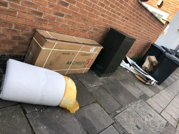 Mattress and rubbish left near bins-312-314 St Saviour's Road, Leicester, LE5 4HJ