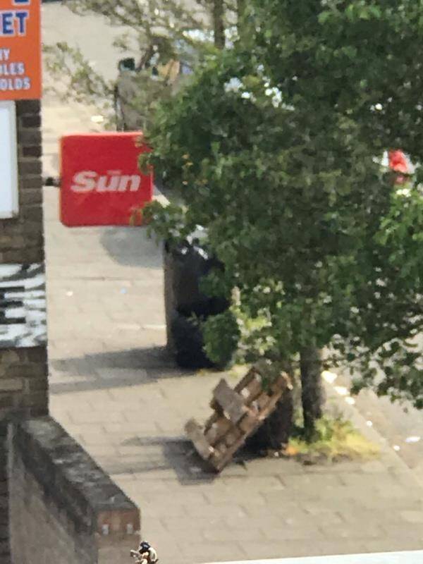 Crate dumped on pavement and black bags of rubbish -Frontier Works, 33 Queen St, London N17 8JA, UK