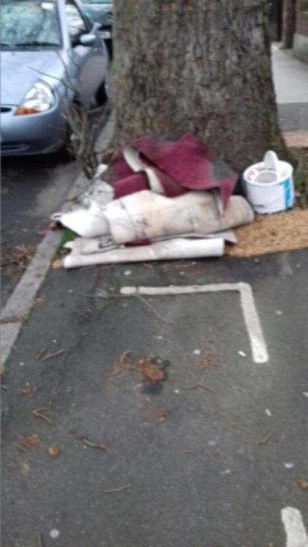 Pieces of carpets and a  paint container dumped outside 487 Barking Road -491 Barking Road, London, E13 8PS