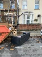 I've already reported this but you said you couldn't find it. It's very clear. A large sofa in the street next to the skip. Dumped by a man with a van. Registration YX63GXK.-58 Colegrave Road, London, E15 1ED