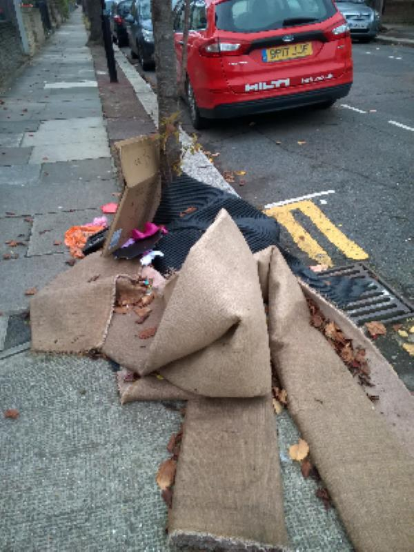 carpet, cardboard box outside 50-50 Park Road, London, E15 3QP