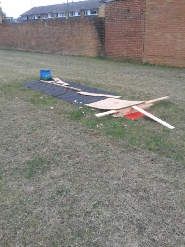 Building materials have been dumped on the grass in front of 38 Bromley Walk, Tilehurst which has resulted in the grass not being cut properly. Also, the edges of the grass have not being properly. -12 Bromley Walk, Reading, RG30 4LR