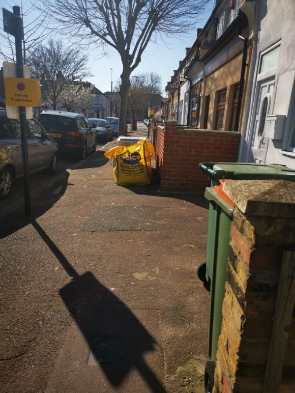 It's been more than 2 days since this neighbour has left 2 sand bags o the footpath and a pallet with blocks... -65a Market Street, London, E6 2RD