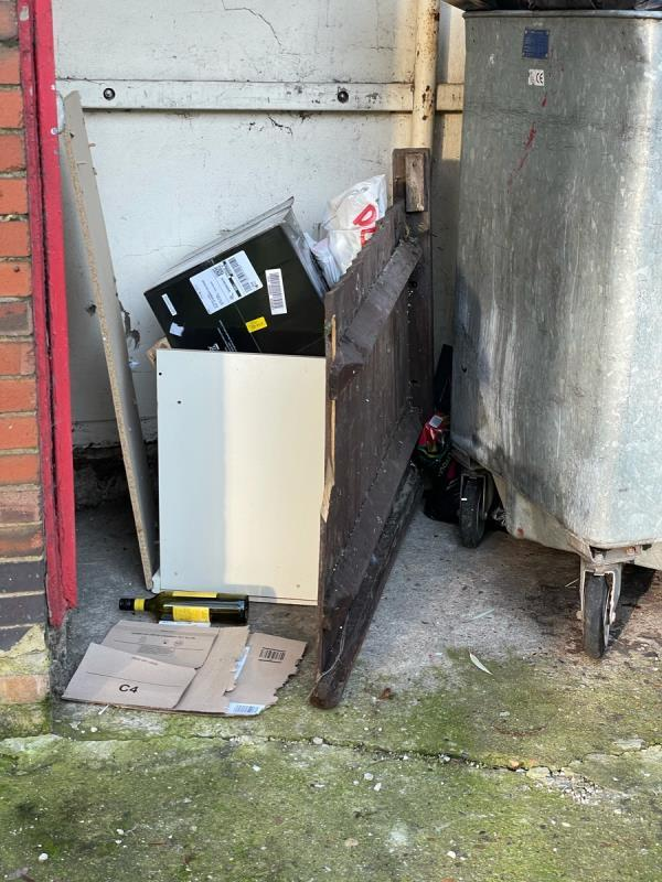 A number of items have been dumped next to the metal bin-Kennedy Cox House Burke Street, Canning Town, E16 1EU