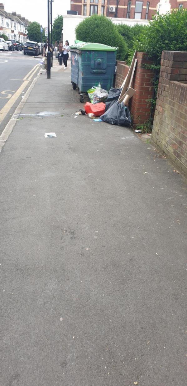 Fly tipping next to large bins-261 High St N, London E12 6SJ, UK