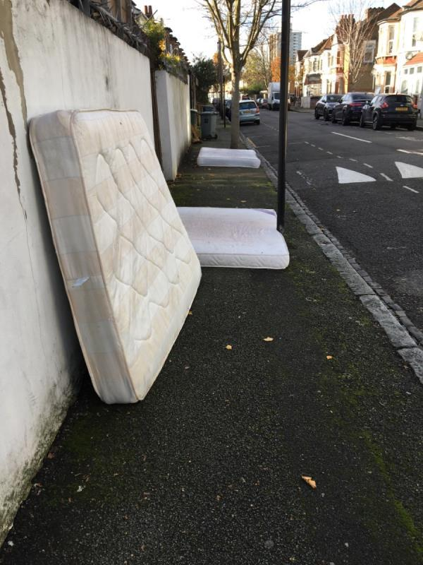 3 mattresses discarded on the pavement. One flat down blocking the pathway -30 Margery Park Road, London, E7 9JY