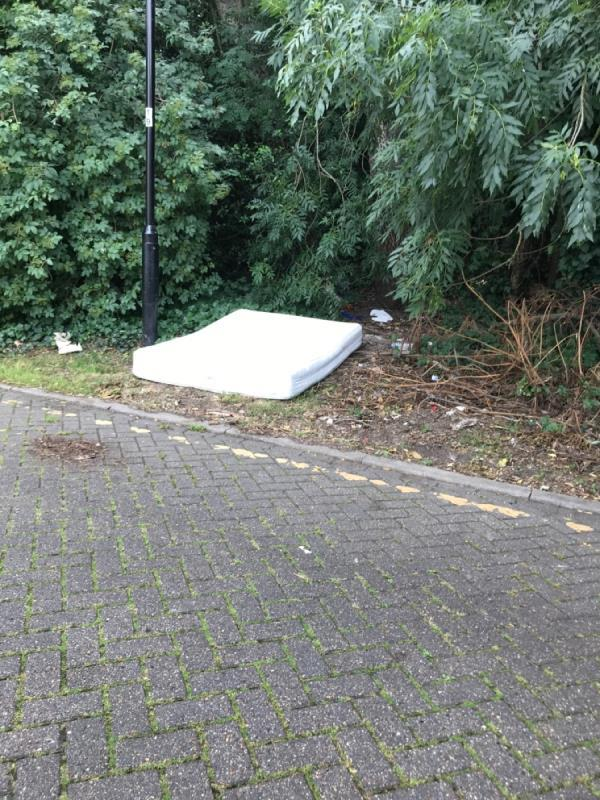 A bed and some other bedroom furniture has been flytipped -120 Covelees Wall, London, E6 6WF