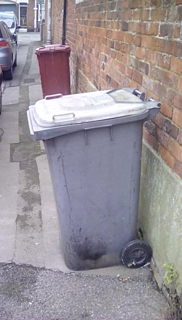 2  unclaimed bins (plus half a broken bucket of paint & an oil bottle) left outside the property for a week and a half. Don't belong to any immediate residents-1Cambridge Street, Reading, RG1 7NT