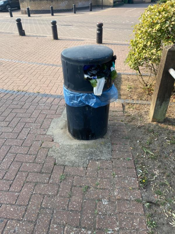 All the litter bins around the green at Britannia Village need emptying. -12 West Mersea Close, Canning Town, E16 2AR