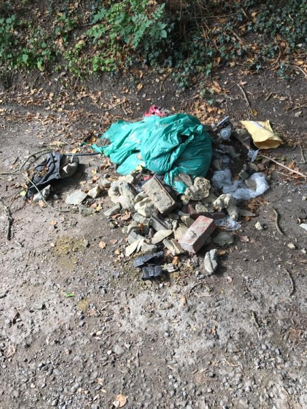 Fly tipped rubble in Southcote Farm Lane still there more than one week after first report-23 Southcote Farm Lane, Reading, RG30 3DY