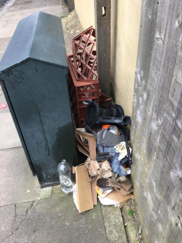 Flytipper left rubbish beside the green cable box-Railway Arches 381 To 383 Strode Road, London, E7 0DU