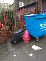 Dumped commercial food waste on pavement and foul chicken pieces. Blocking fire exit and muster point and pedestrian entrance and exit gate.  image 1-3 Clyde Vale, London, SE23 3JG