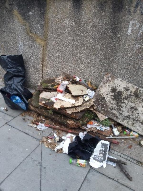 open bin bags dumped at end of Lyndhurst Road beside dumped concrete from the driveway next to them-4 Lyndhurst Road, London, N22 5AT