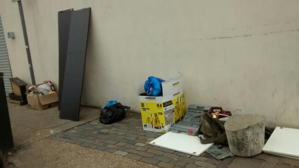 items left along the wall by goldline garage in Carlyle Road E 12. Right in view of the cameras-25 Carlyle Road, London, E12 6BL