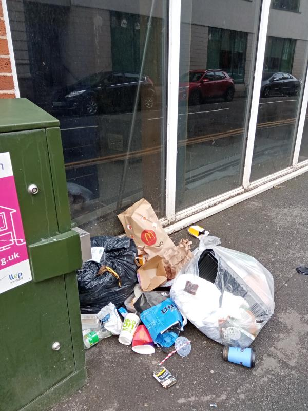 Fly-tipping outside Blenheim Court, Church Street.  There has been a pile of domestic waste at this location for 2-3 weeks - previously reported but no action taken.  The pile is being added to on a daily basis.  A takeaway delivery receipt is visible amongst the rubbish, identifying at least one of the properties to which the waste belongs.-148 Charles Street, Leicester, LE1 1LB