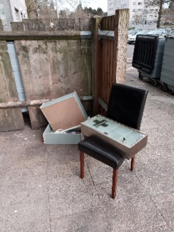 Fly tipping by the bins at block 203 Wensley Rd. Black Chair, chest of drawer cupboards -Irving Court, 203 Wensley Road, Reading, RG1 6EB