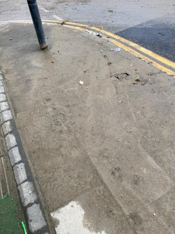 Bradfield road and it's junction with North Woolwich road including N Woolwich road (and surrounding pavements) urgently need sweeping. Area is covered in sand and gravel.  image 1-46 Bradfield Road, London, E16 2AX