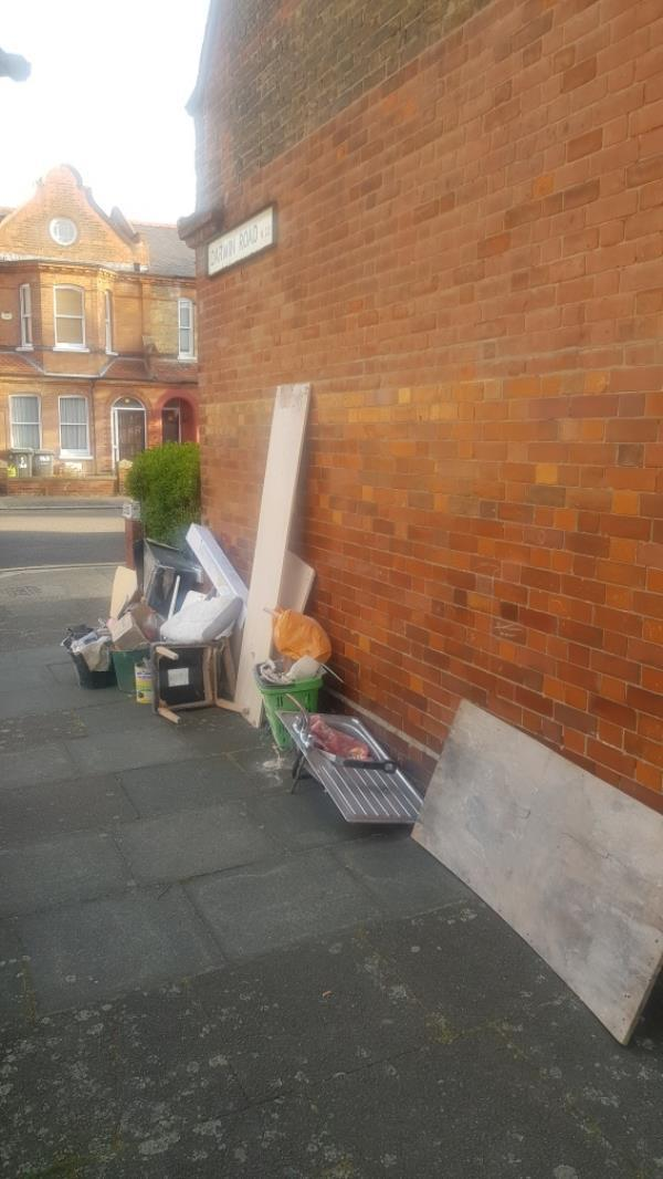 dumped rubbish fly tipping corner of Darwin rd and lymington ave huge flytipping -232 Lymington Avenue, London, N22 6JN
