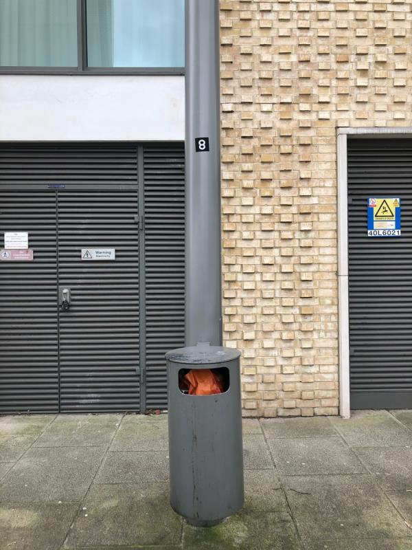 Bin next to pelican crossing on liberty bridge road is full.-Early Rivers House, 5 Elis Way, London, E20 1AJ