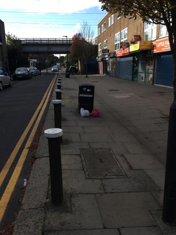 2x litter bins full outside no. 32 and 42 Church Rd N17-35 Church Rd, London N17 8AQ, UK