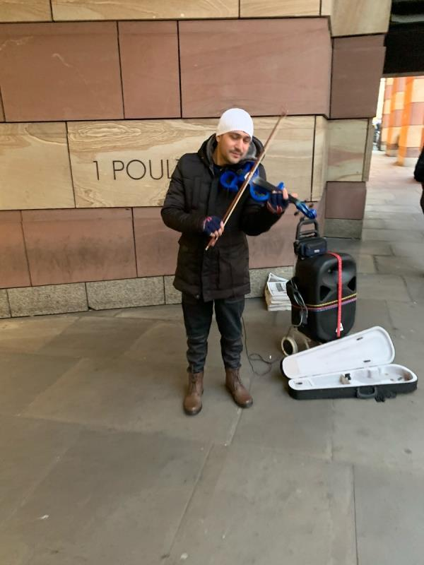 He is back with his fake music. Please can you take action against this fake busker   Referred to the Environmental Health team. -38 Poultry, London, EC2R 8DN