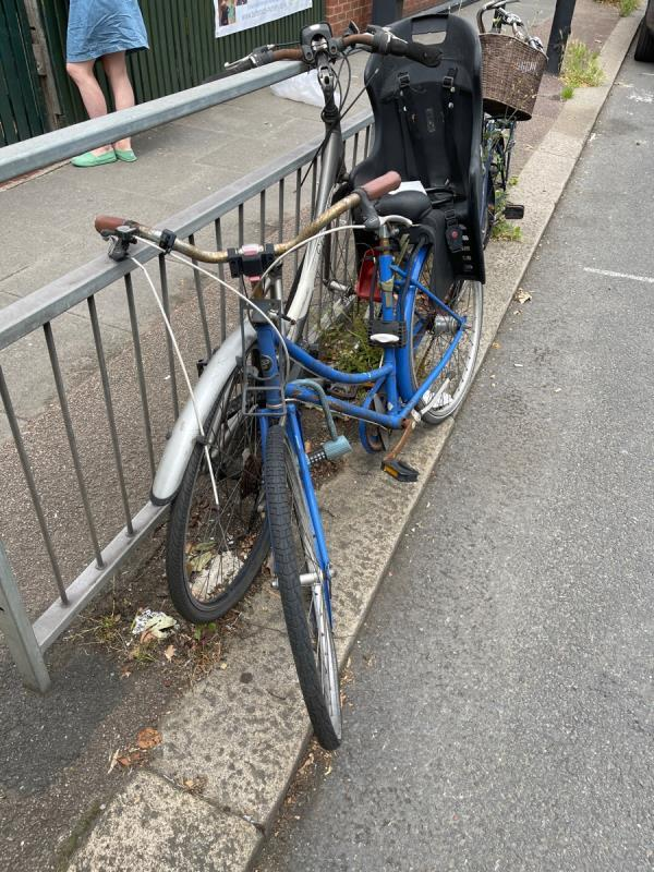 4 bikes attached to railing outside buttercups day nursery on old oak road -25 Old Oak Road, Acton, W3 7HN