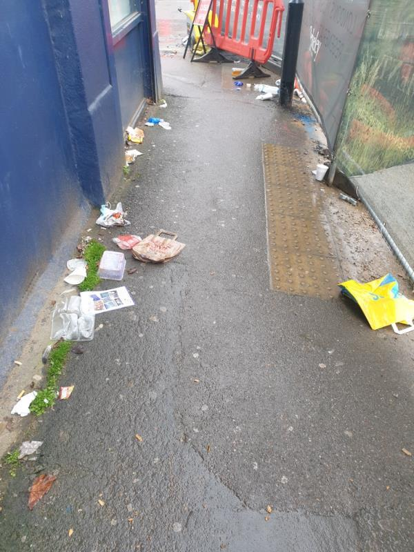 Street litter lots of it in front of the shops pavement area-6 The Crescent, London, UB1 1BE