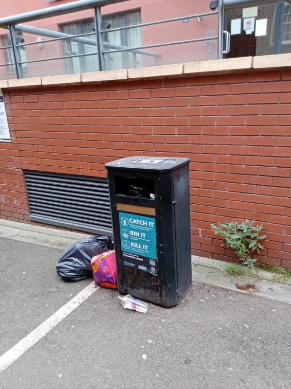 Overflowing litter bin, domestic waste outside 3 Colton Square.  The litter bin on the footpath next to St George's Church is also full.-3 Colton Square, Leicester, LE1 1QH