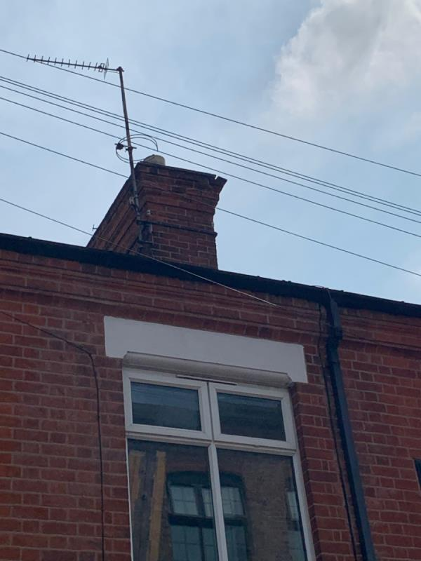 Chimney bricks dangerously loose. Hazard of falling into street or onto tenant. Landlord was contacted but isn't taking action, however it is really dangerous for people walking past the house. A builder highlighted the problem, and said it needs sorting as soon as possible.-50 Bede Street, Leicester, LE3 5LD