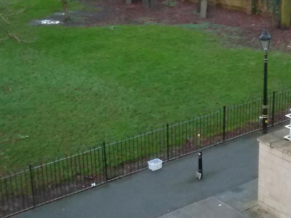 Plastic container box blown across from fly-tipped rubbish left outside Blenheim Court over the weekend.-1 Colton Square, Leicester, LE1 1QH