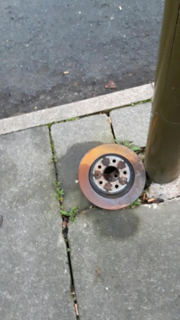 Brake discs left on footway.-761 Saffron Lane, Leicester, LE2 6TG