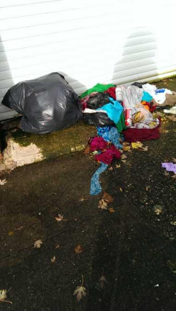Indian clothing dumped at garages again on bramall road,last lot just been cleaned and another lot dumped-12 Frewin St, Leicester LE5 0PA, UK