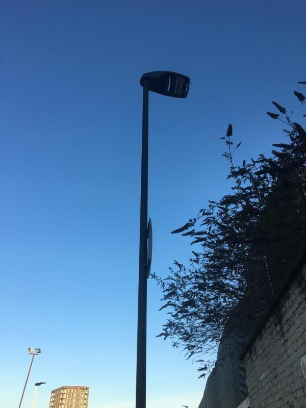 Light fitting on column on Bradfield Road opposite junction with Knights Road hanging off -Manhattan Wharf Knights Road, London, E16 2AT