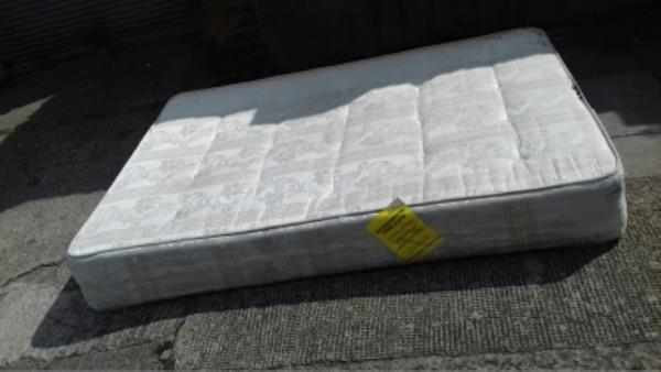 A mattress dumped at Stirling Road near no 2 opposite Plaistow Library -83 North Street, London, E13 9HL
