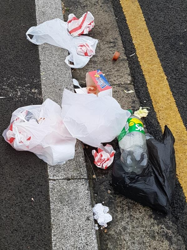 rubbish left on floor, pavement and road near side road of house 183 central park road E6 -185 Central Park Road, London, E6 3AE
