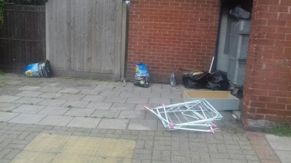 Bags of wastes and household wastes dumped outside the bins room at the rear of Block 48 to 56 Devonshire Road -20 Devonshire Road, Canning Town, E16 3NB